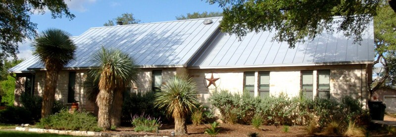 House after standing seam roof installation