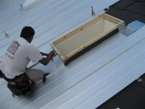 Man working on metal roofs
