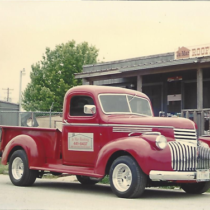 classic red truck with ja-mar roofing logo on the door