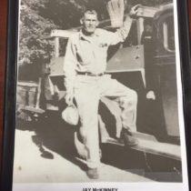 jay mckinney standing on truck rail in 1946